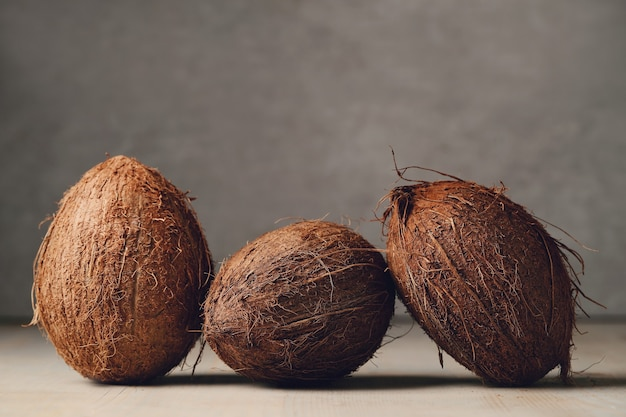 Coconuts over wooden table