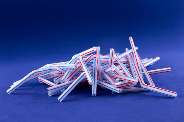 Coctail plastic tubes on blue purple