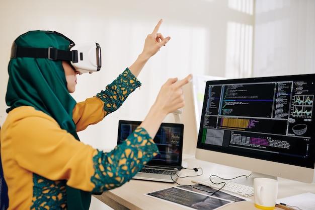 Coder testing virtual reality app