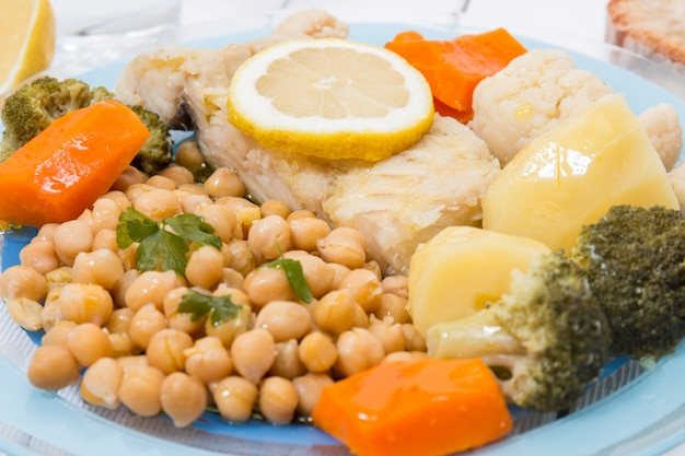 Codfish with chickpeas and vegetables