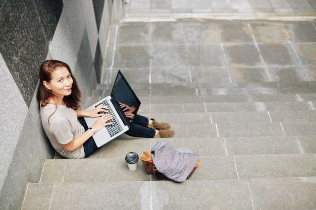 Coding young woman