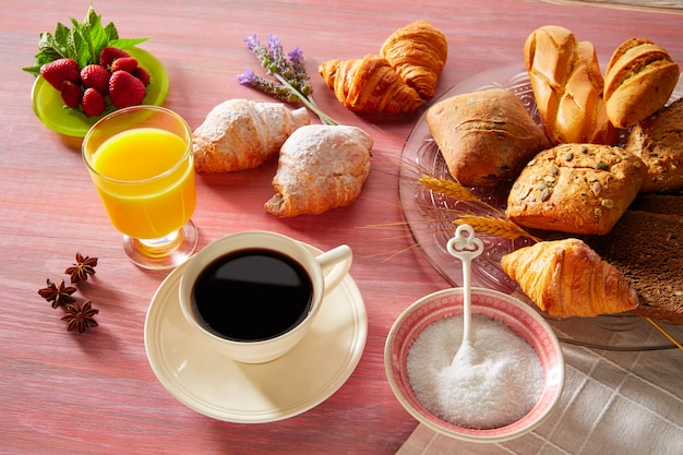 Coffe breakfast with orange juice croissant bread