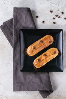 Coffe eclair with coffee beans