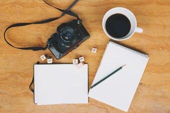 Coffee and camera near notebooks