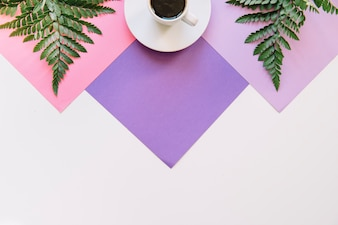 Coffee and exotic leaves on geometric background