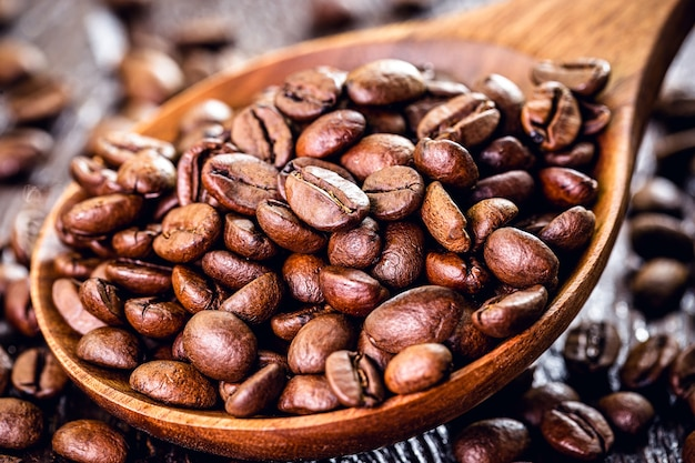 Coffee arabic beans with wooden spoon