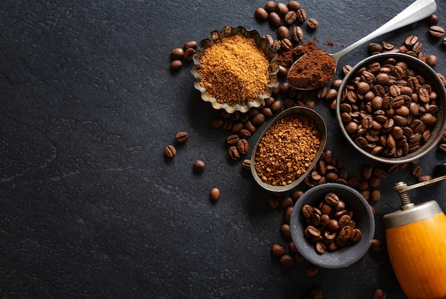 Coffee background or coffee concept with coffee beans on bowls and sugar.  view from above