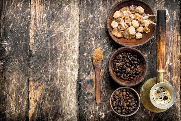 コーヒーの背景豆と淹れたてのコーヒー