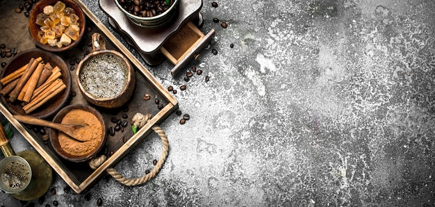 Coffee background. welded coffee in a turkish with sugar, cinnamon and coffee beans. on a rustic background.