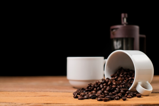 Coffee backgrounds, coffee cup and coffee french press on rustic wooden table with copy space