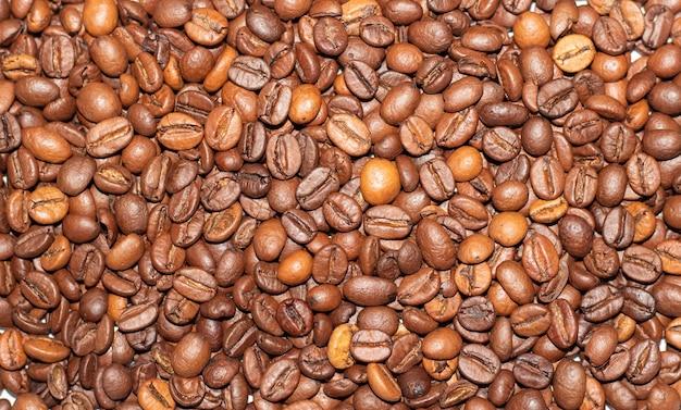 コーヒー豆の背景のクローズアップコーヒー豆のテクスチャ