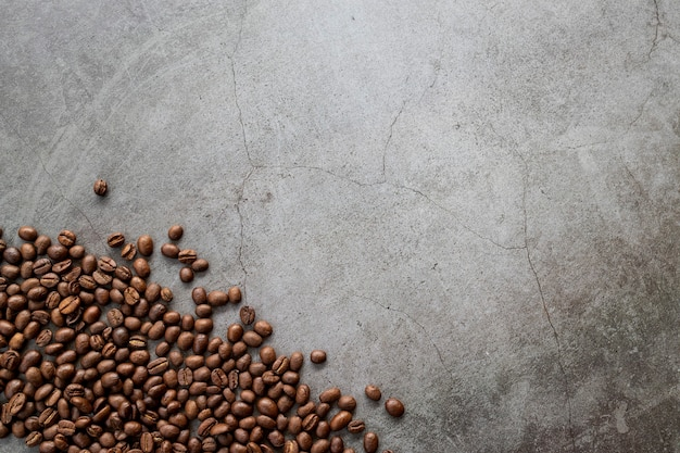 Coffee bean and hand grinder on old cement background