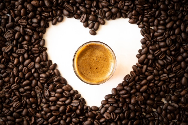 Coffee bean heart on white background. coffee lover concept