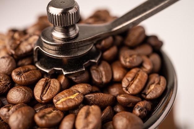Coffee bean roasted in wooden grinder.