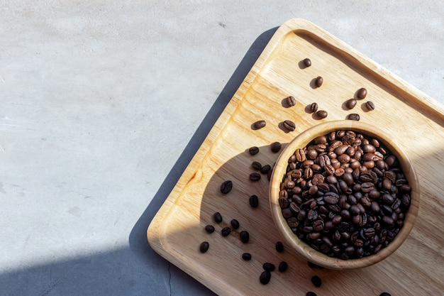 Coffee bean in wooden cup on desk
