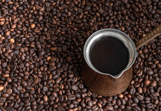 Coffee beans background and intage cezve (turkish coffee). layout design with copy space