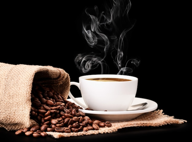 Coffee beans in a bag and a cup with aromatic coffee
