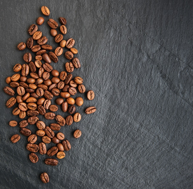 Coffee beans on a black surface
