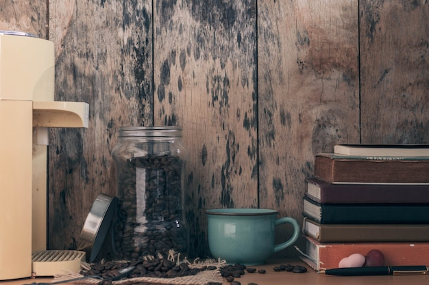 Coffee beans and books on table.