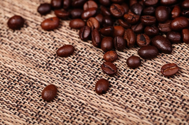 Coffee beans on the brown background
