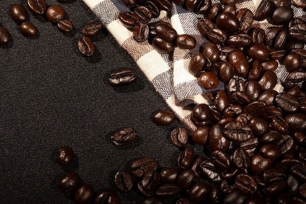 Coffee beans on brown linen fabric