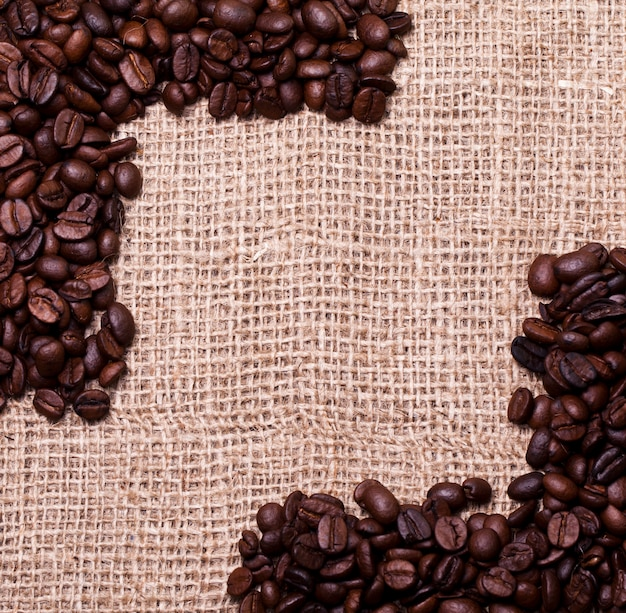 Coffee beans over cloth sack