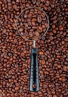Coffee beans in a coffeepot or turk on coffee beans top view