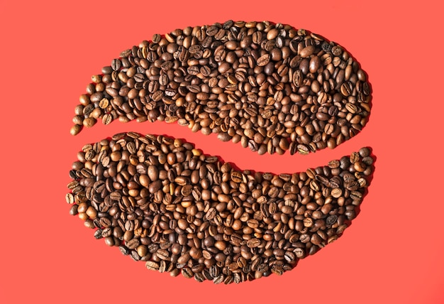 Coffee beans on creative pink background