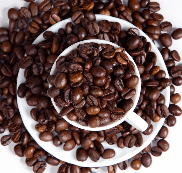 Coffee beans in a cup (focus in the first plane)