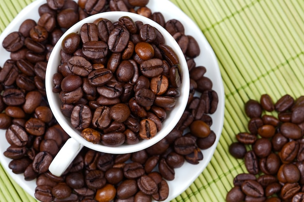 Coffee beans in a cup - focus in the frist plane -