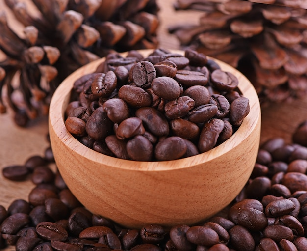 Coffee beans in a cup wood