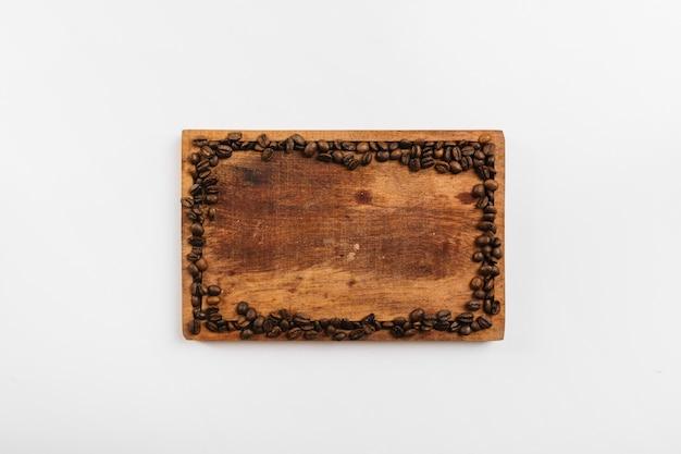 Coffee beans on cutting board
