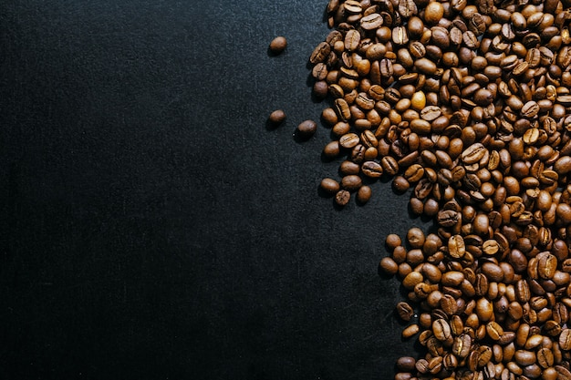 Coffee beans on dark background. top view. coffee concept.