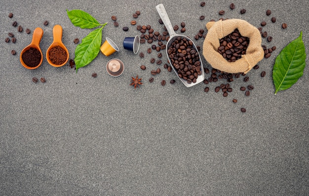 Coffee beans on dark stone .