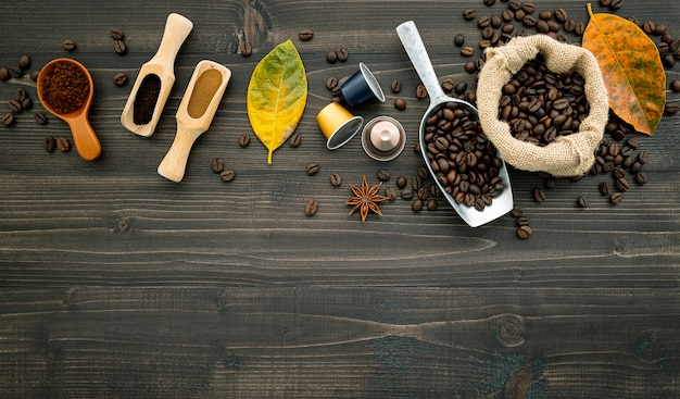 Coffee beans on dark wooden .