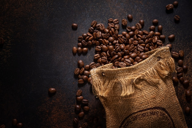 Coffee beans espresso closeup in jute sack bag.