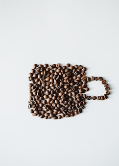 Coffee beans in form cup