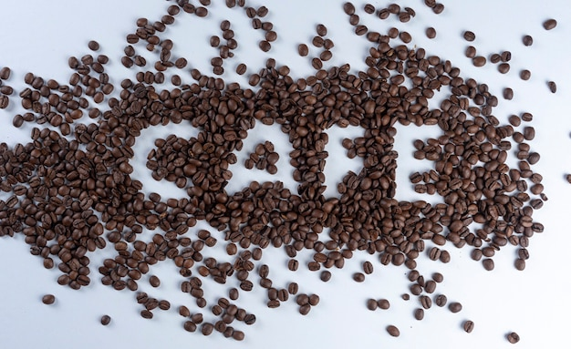 Coffee beans forming the word coffee in portuguese.