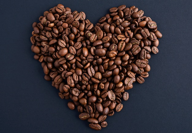 Coffee beans in heart shape white background isolated