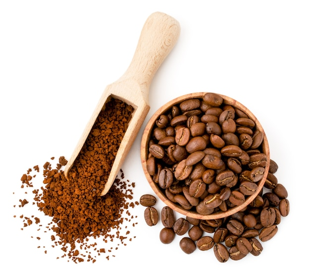 Coffee beans and instant coffee in wooden utensils