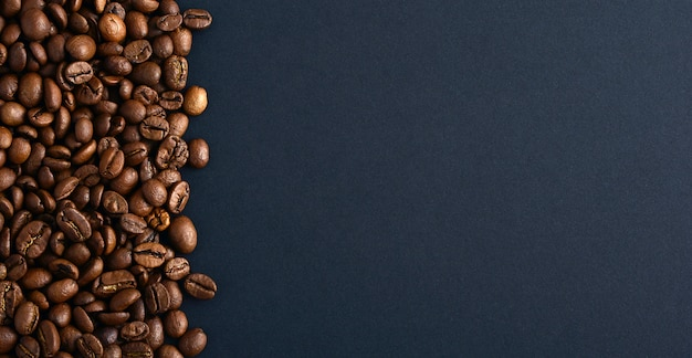 Coffee beans on the left. copy space. top view.