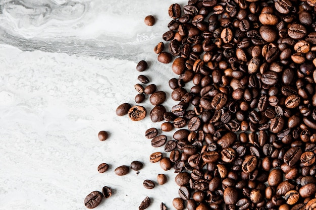 Coffee beans on marble background with copy space for text. coffee background or texture concept.