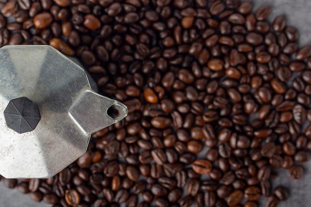 Coffee beans and moka pot coffee