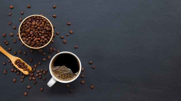 Coffee beans on old black table