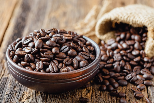 Coffee beans on old wood