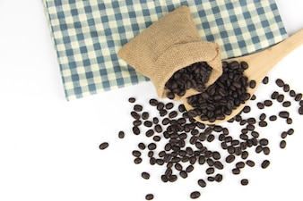 Coffee beans on sack and wooden spoon