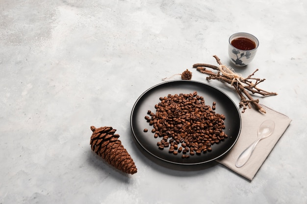 Coffee beans on plate copy space