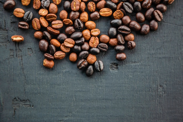 Coffee beans roasted on black, top view