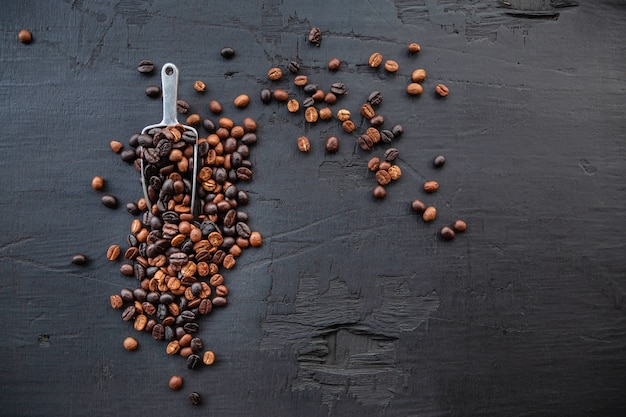 Coffee beans roasted on a black wooden background
