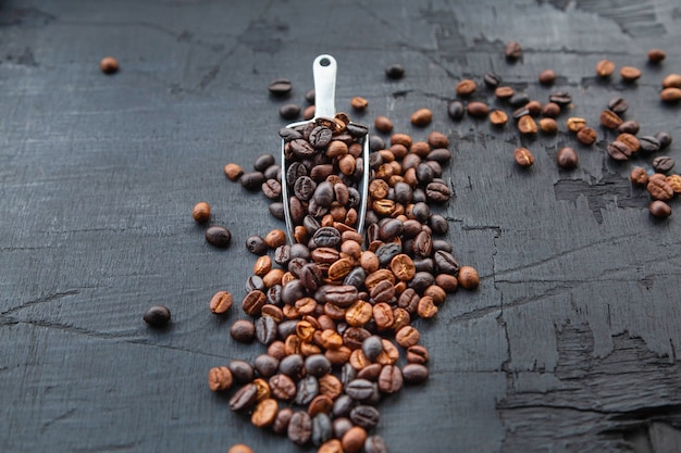 Coffee beans roasted on a black wooden